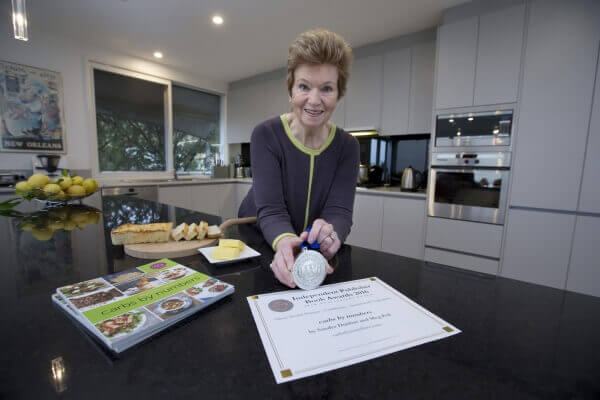Sandra Dunbar with IPPY award for carbs by numbers recipe book-sml